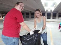 Students picking up trash at last semester's parking deck clean up!